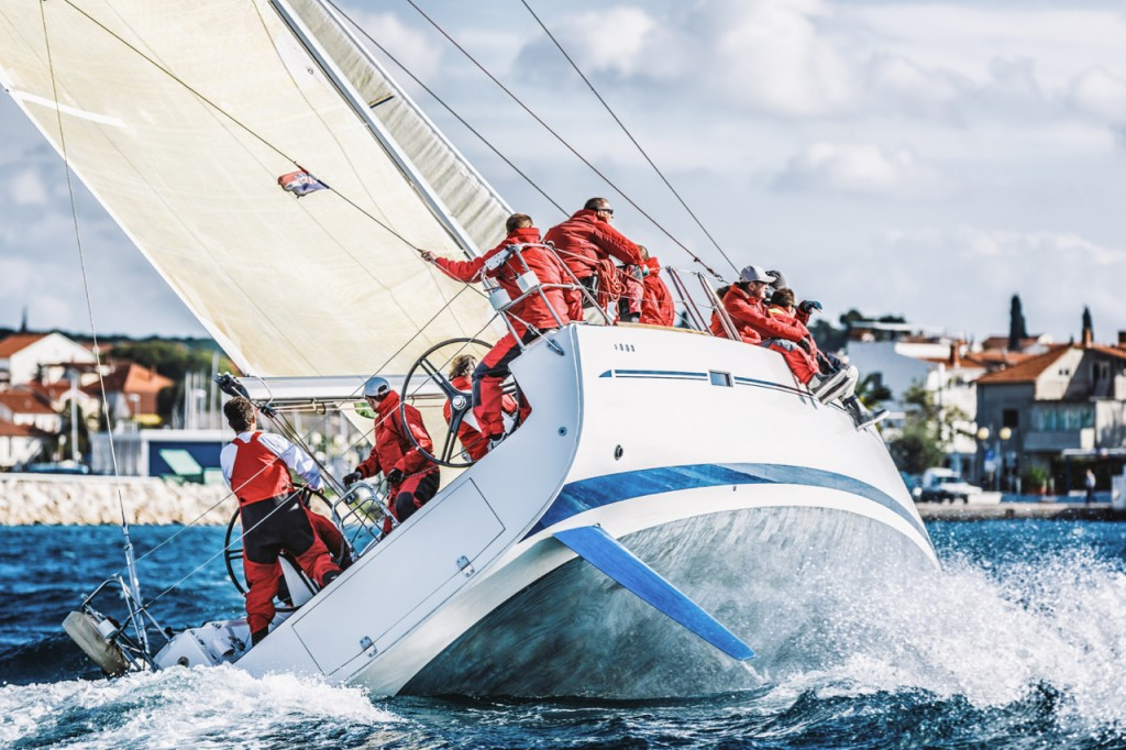 Sailing racing crew on sailboat during regatta