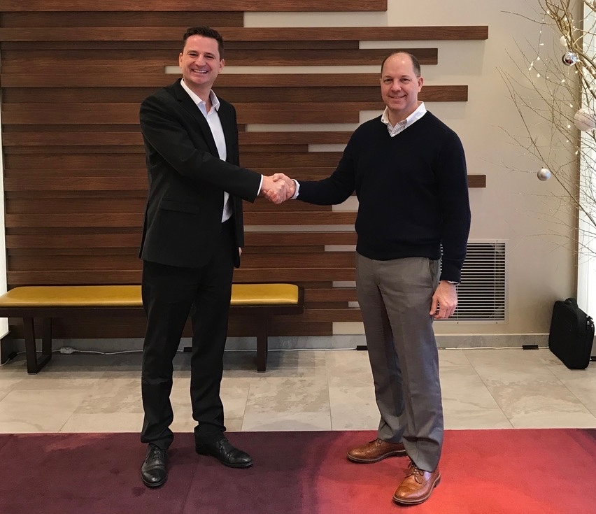 Jan Andre Heggem of SMSGlobal and John Dark of RedPort Global sign strategic agreement